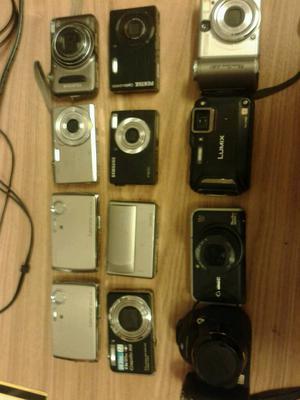 Job lot of 12 digital cameras spares or repairs