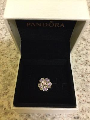 Genuine Pandora sparkling primrose charm. Absolutely beautiful charm. Great condition. £25