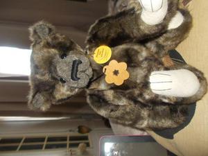 percival charlie bear wearsa wooden flower necklace