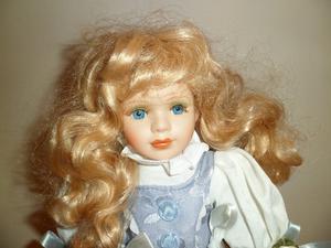 Stunning Porcelain doll.
