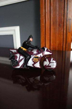 Cartoon Batman Figure On Motor Bike
