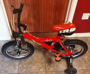 Red Raleigh Kids bike with stabilisers (wheel size )