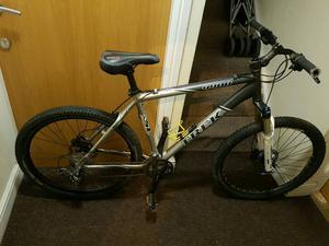 Trek mountain bike with fluid brakes