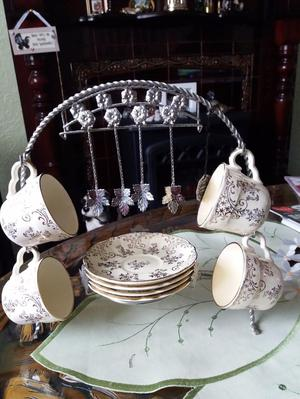 VINTAGE BRAMA CUPS AND SAUCERS ON STAND