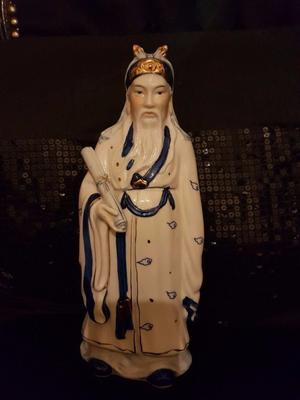 Vintage blue and white porcelain emperor holding a scroll