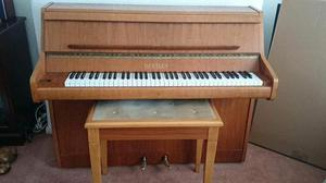 's Bentley upright piano and stool