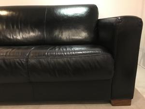 Black leather sofas x 2.