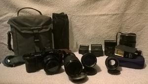 Vintage retro Olympus OM77AF 35mm camera and lenses