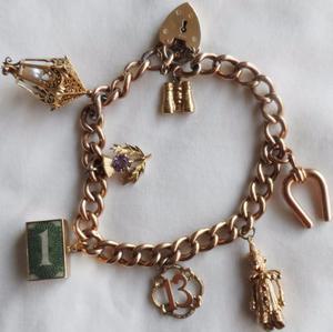 9ct Gold Charm Bracelet. 33g not scrap