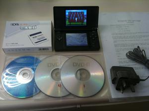 black ds lite complete with approx 600 games c/w pokemon