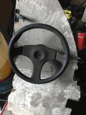 Steering wheel/gear for a boat