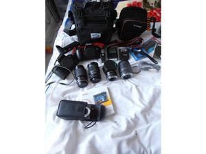 2 Canon Cameras with lenses and many other items, also