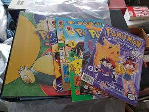 *Perfect Condition* Pokemon Card Game Binder & 5 Comics