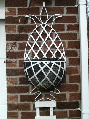 A Large Wall Haning Basket in the Shape Of A Pineapple