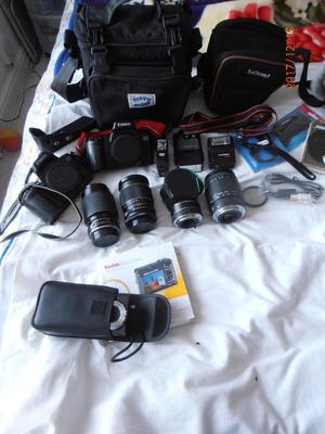 2 Canon Cameras with lenses and many other items, also digital camera