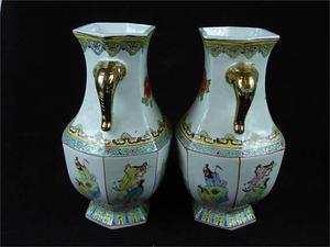 A pair of large Chinese porcelain vases with twin gilt eleph