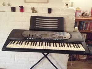 Casio CTK 571 Electric keyboard and 6 music books