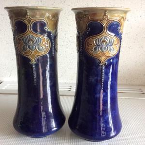 A pair or Doulton Lambeth stoneware vases.