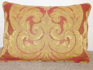 Four red and gold cushions