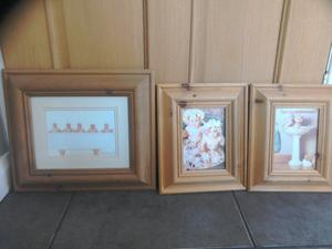 Set of 5 Anne geddes baby pictures in solid pine frames.£40