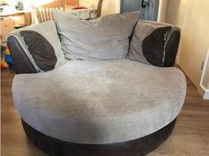 Large swivel chair and half moon footstool. in Romsey