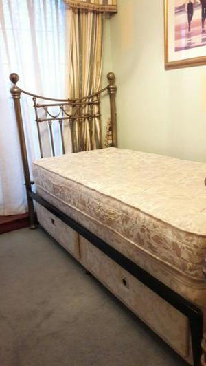 Single bed with ornate headboard and divan
