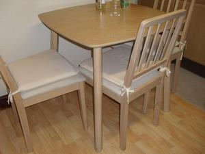 Light Oak colour dining table and 4 chairs - compact