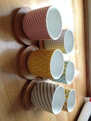 6wonderful tea cups with wooden saucer