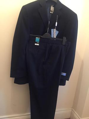 """Marks and Spencer's suit. Jacket length short.size: chest 38"""", Trousers waist 34"""", length 29""""."""