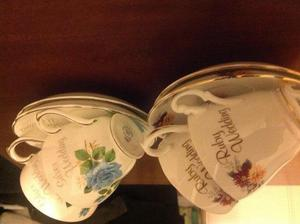 Two pair ofSilver wedding and Ruby wedding cups and saucers.