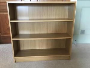 Oak coloured wooden book shelves