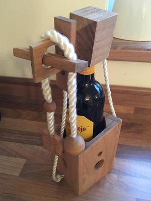 Wooden wine bottle puzzle