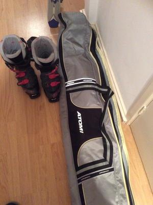 Skis, poles, boots and bag