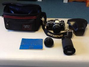 35 mm Olympus film camera and accessories.