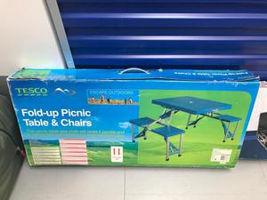 Camping pop up table and 4 seat bench.