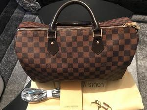 Louis Vuitton speedy 35cm, comes with dust bag,lock and card NEW?