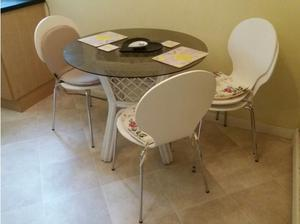 Glass table with 4 chairs in Poole