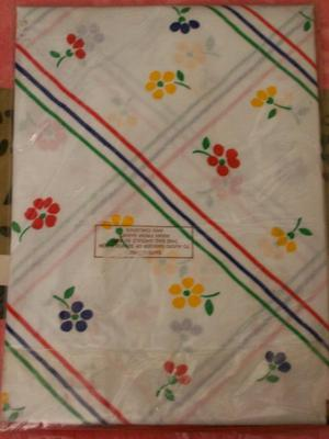 New Pillowcase. White with Red, Green, Blue & Yellow Pattern