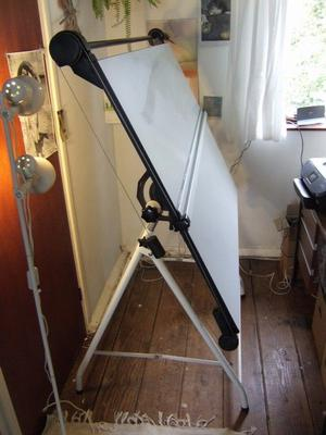 A0 drawing board with proprietary tilting foldaway stand. Very good condition.