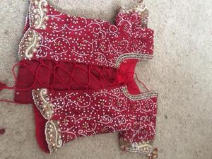 Khushboos Red and Gold Bridal Lengha