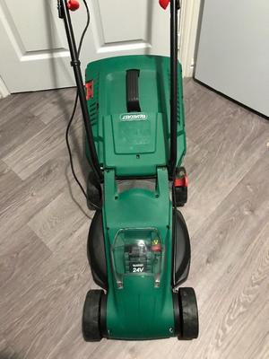 Qualcast 24v cordless lawnmower with battery and charger used once