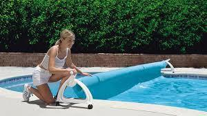 Roller for swimming pool bubble cover