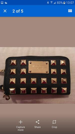 Michael kors limited edition studded bag and matching purse