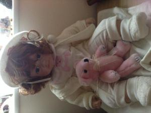 Porcelain baby girl doll by leanardo