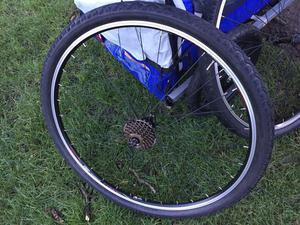 700c rear mountain bike wheel, quick release.