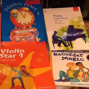 Eleven music books for singing, violin, piano, recorder and others.