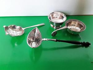 3 Vintage solid silver tea strainers