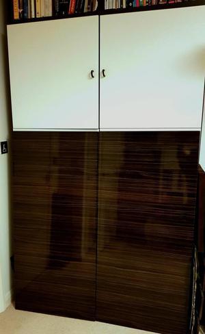 A pair of Black/Brown Ikea Besta Doors