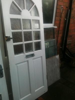 Exterior hardwood door with patterned glass