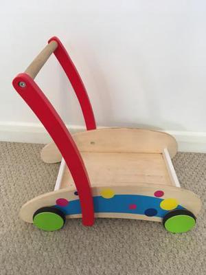 Lovely wooden walker with multi coloured bricks